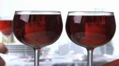 Clinking glasses of red wine Stock Footage