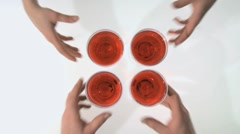 Toasting with four glasses of red wine Stock Footage