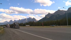 Trucking, two transport trucks in the rocky mountains Stock Footage