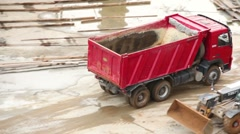 Empty tipper truck leaving from construction site Stock Footage