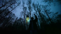 Man plays glowing toy in the dark forest, long exposure Stock Footage