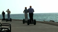 Segway driving by the sea Stock Footage