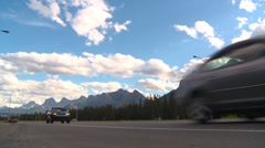 Trucking, single transport truck mountains low angle Stock Footage