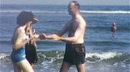Stock Video Footage of Father Throws Daughter into the Ocean 1950 (Vintage Film 8mm Home Movie) 366