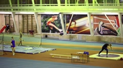 Athlete came and began to prepare after another one put the shot in gymnasium Stock Footage