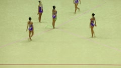 Gymnasts with ribbons from China begin their performance - stock footage