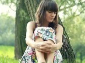 Young, sad, lonely beautiful woman face in the park, dolly shot NTSC Stock Footage