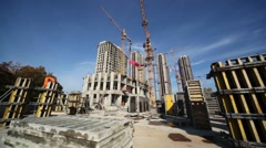 Working cranes inside place for with buildings under construction Stock Footage