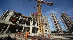 Workers lift the valve using a high crane on construction site Stock Footage