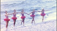 Stock Video Footage of WATER SKI GIRLS Glide to Shore BEACH 1950s Vintage Film Retro Home Movie 375