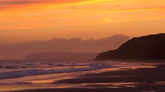 The last light of the evening over a sandy bay, no people Stock Footage