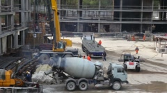 Cement mixer drives away next one arrives immediately Stock Footage