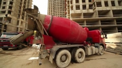 Concrete mixer stand at building place, truck full of sand arrives Stock Footage
