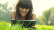 Young happy woman with tablet computer on meadow HD Stock Footage