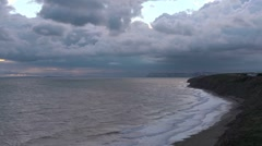 Storm clouds over a sandy bay, Time lapse Stock Footage