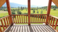 Balcony of a log home dolly Stock Footage