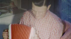 Man Plays Accordion MUSIC INSTRUMENT 1950s Vintage Film Home Movie 383 Stock Footage