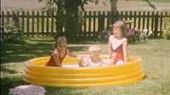 Children Backyard in Kiddie Pool Circa 1950s (Vintage Film 8mm Home Movie) 384 Stock Footage