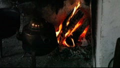 Firewood burning next to a three-legged kettle Stock Footage