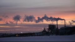 Factory chimneys fuming at sunset  Stock Footage