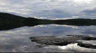 Stock Video Footage of Cloudy sky reflected in a calm lake