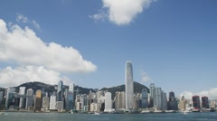 HongKong Skyline and victoria habour - tilt down - stock footage