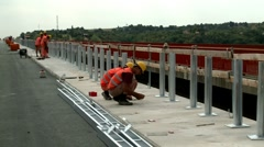 Workers on a bridge Stock Footage