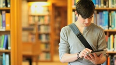 Young man with a tablet - stock footage