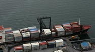 Stock Video Footage of Cargo Ship Loads Trucks Time Lapse