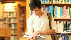Young man reading a book - stock footage