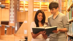 Students reading a book together - stock footage