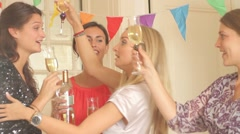 Woman kissing and congratulating other female on birthday party Stock Footage
