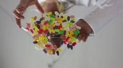 Woman selecting jelly beans Stock Footage