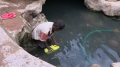 Somalia: IDP collects water Stock Footage