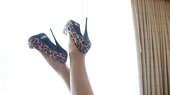 Sexy animal print high heels in the air Stock Footage