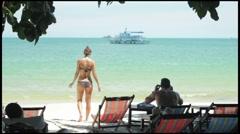 Woman in Bikini Walking towards the Ocean Stock Footage