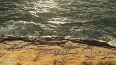 Waves Crashing on Rock tilt to Sunset Ocean Horizon Stock Footage