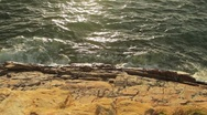Stock Video Footage of Waves Crashing on Rock tilt to Sunset Ocean Horizon