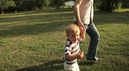 Father and son running on meadow Stock Footage