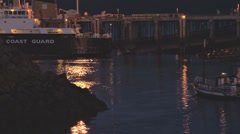 Classic Wooden Boat Leaving Harbor at Night Stock Footage