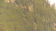 Mountain forest fire, Mt Buller #44, helicopter torcher starts fire. Stock Footage