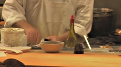 Busy Restaurant Kitchen Cook Places Plate on Counter - pan Stock Footage