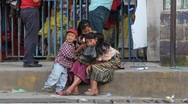 Stock Video Footage of Mother with children sitting on curb in Guatemala City