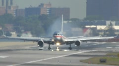 American AA airlines jet airplane touchdown arrival runway laguardia - stock footage