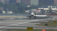 Stock Video Footage of Small jet express landing arrival touchdown ariport runway laguardia