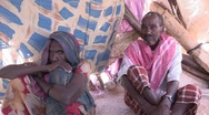 Stock Video Footage of Somalia: Man and one of His Wives