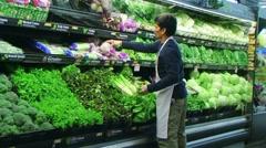 Man Facing Vegetables In Produce - stock footage