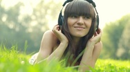 Stock Video Footage of Woman with headphones listen to the music in the park
