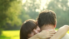 Woman hugs and kiss man, outdoors, slow motion Stock Footage