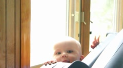Baby stand up and smiles Stock Footage